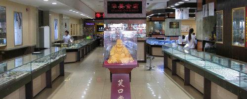 黑��江�A美金店